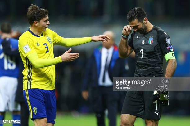 Victor Lindelof of Sweden comforting Gianluigi Buffon of Italy at the end of the match at San Siro Stadium in Milan Italy on November 13 2017
