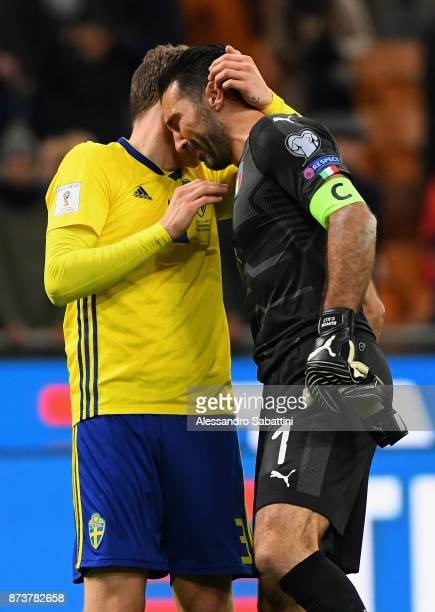 Victor Lindelof of Sweden embraces Gianluigi Buffon of Italy during the FIFA 2018 World Cup Qualifier PlayOff Second Leg between Italy and Sweden at...