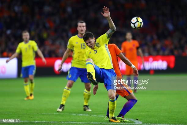 Victor Lindelof of Sweden is challenged by Tonny Vilhena of Netherlands during the FIFA 2018 World Cup Qualifier between Netherlands and Sweden at...