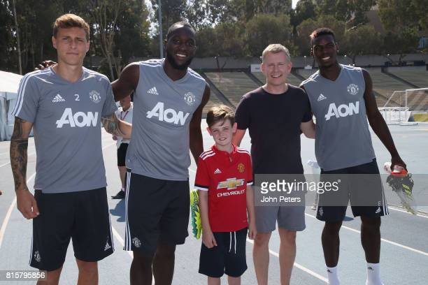 Victor Lindelof Romelu Lukaku and Paul Pogba of Manchester United pose with Comedian Patrick Kielty and his nephew Harry ahead of a first team...