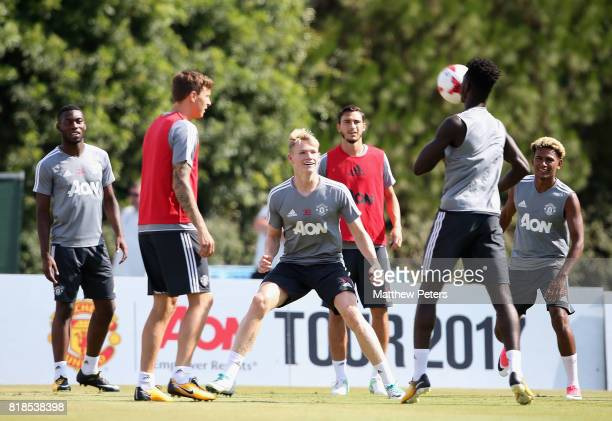 Victor Lindelof Scott McTominay Axel Tuanzebe and Demitri Mitchell of Manchester United in action during a first team training session as part of...