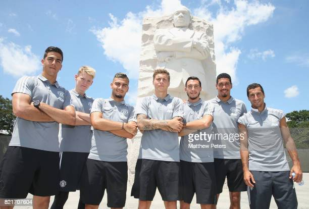 Victor Lindelof Scott McTominay Joel Pereira Andreas Pereira Henrikh Mkhitaryan Matteo Darmian and Chris Smalling of Manchester United take part in a...