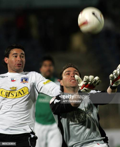 Victor Loyola of Audax Italiano tries to catch the ball against the mark of Claudio Bieler of ColoColo during their Copa Sudamericana match 04...
