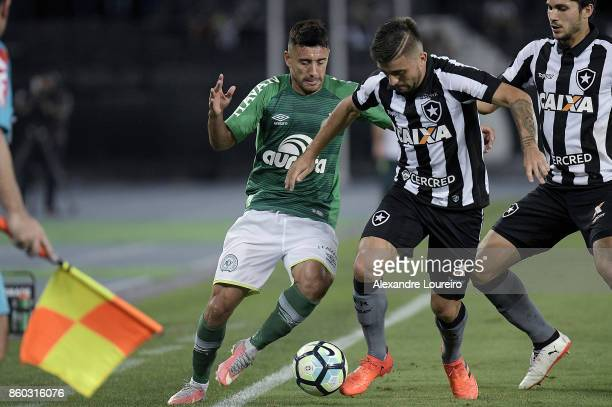 Victor Luis of Botafogo battles for the ball with Alan Ruschel of Chapecoense during the match between Botafogo and Chapecoense as part of...
