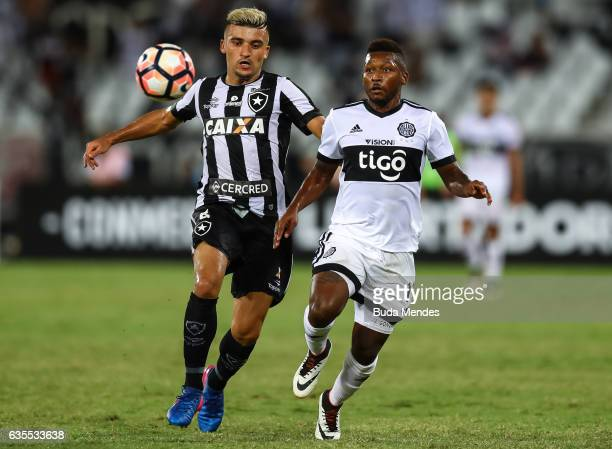 Victor Luis of Botafogo struggles for the ball with Jonathan Gonzalez of Olimpia during a match between Botafogo and Olimpia as part of Copa...