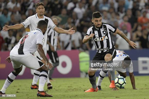 Victor Luis of Botafogo runs with the ball during the match between Vasco da Gama and Botafogo as part of Brasileirao Series A 2017 at Maracana...