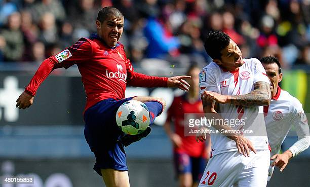 Victor Machin of Sevilla FC duels for the ball with Francisco Andres Silva of CA Osasuna during the La Liga match between CA Osasuna and Sevilla FC...