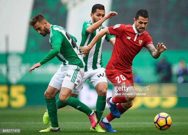Victor Machin Perez 'Vitolo' of Sevilla FC being followed by German Pezzella of Real Betis Balompie and Petros Matheus dos Santos of Real Betis...