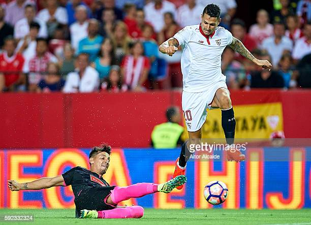 Victor Machin Perez 'Vitolo' of Sevilla FC being followed by Hernan Perez of RCD Espanyol during the match between Sevilla FC vs RCD Espanyol as part...