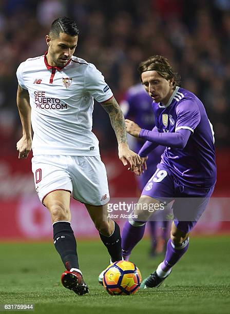 Victor Machin Perez 'Vitolo' of Sevilla FC being followed by Luka Modric of Real Madrid CF during the La Liga match between Sevilla FC and Real...