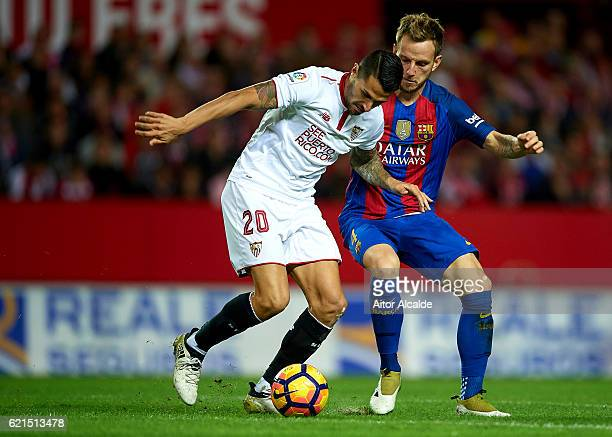 Victor Machin Perez 'Vitolo' of Sevilla FC competes for the ball with Ivan Rakitic of FC Barcelona during the match between Sevilla FC vs FC...