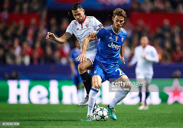 Victor Machin Perez 'Vitolo' of Sevilla FC competes for the ball with Daniele Rugani of Juventus during the UEFA Champions League match between...