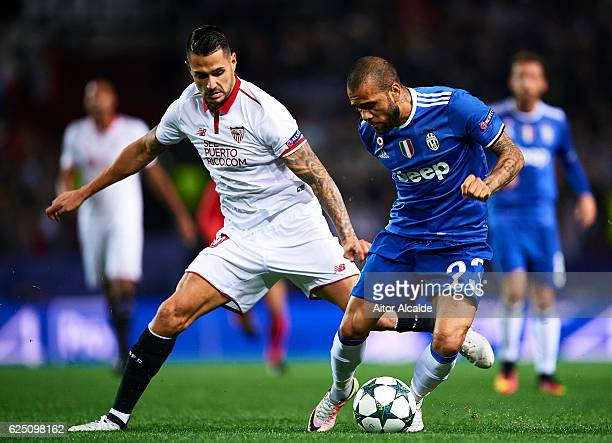 Victor Machin Perez 'Vitolo' of Sevilla FC competes for the ball with Daniel Alves of Juventus during the UEFA Champions League match between Sevilla...