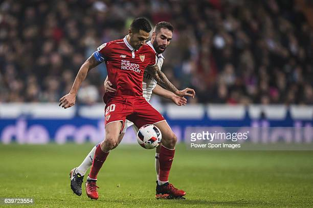 Victor Machin Perez 'Vitolo' of Sevilla FC competes for the ball with Daniel Carvajal Ramos of Real Madrid during their Copa del Rey Round of 16...