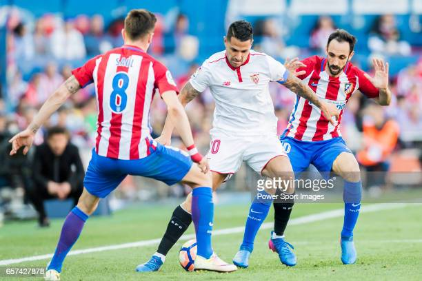Victor Machin Perez Vitolo of Sevilla FC competes for the ball with Vicente Iborra de la Fuente and Juan Francisco Torres Belen Juanfran of Atletico...