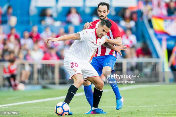 Victor Machin Perez Vitolo of Sevilla FC competes for the ball with Juan Francisco Torres Belen Juanfran of Atletico de Madrid during their La Liga...