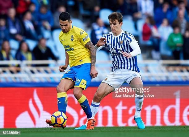 Victor Machin Perez 'Vitolo' of UD Las Palmas duels for the ball with Diego Llorente of Real Sociedad during the La Liga match between Real Sociedad...