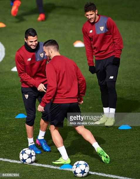 Victor Machin Perez 'Vitolo' Pablo Sarabia and Stevan Jovetic of Sevilla FC chat during their training session prior to their match of Champions...