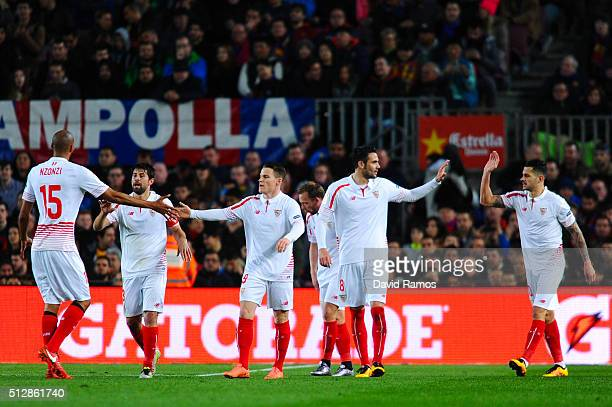 Victor Machin 'Vitolo' of Sevilla FC celebrates with his team mates after scoring the opening goal past Claudio Bravo of FC Barcelona during the La...