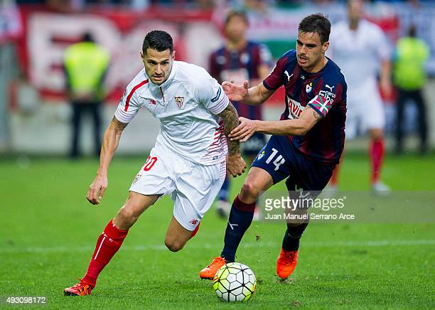 Victor Machin 'Vitolo' of Sevilla FC duels for the ball with Daniel Garcia of SD Eibar during the La Liga match between SD Eibar and Sevilla FC at...