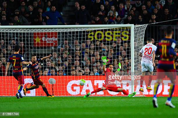Victor Machin 'Vitolo' of Sevilla FC scores the opening goal past Claudio Bravo of FC Barcelona during the La Liga match between FC Barcelona and...