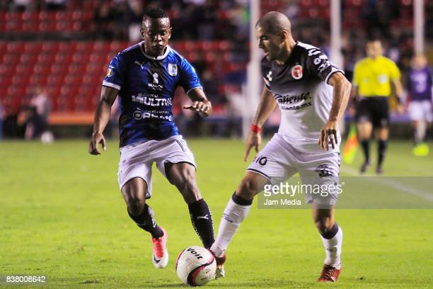 Victor Malcorra of Tijuana fights for the ball with Yerson Candelo of Queretaro during the sixth round match between Queretaro and Tijuana as part of...