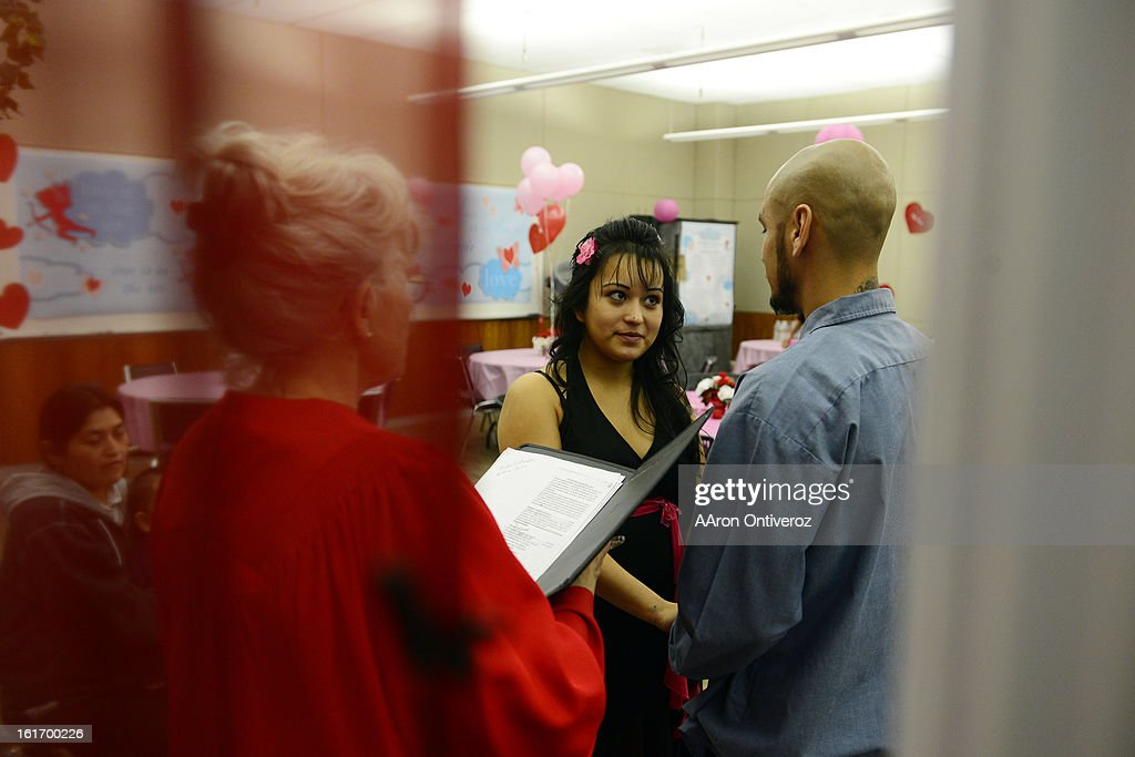 Victor Manuel Villalobos Ramirez and Antonia Vanessa Carreon say their vows during a Valentine's Day marriage celebration at the Denver Clerk and Recorder's office. Couples applying for marriage licenses received gift bags containing gift certificates to local restaurants among other treats to celebrate their union.