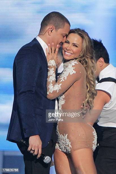 Victor Manuelle and Aylin Mujica on stage during Telemundo's Premios Tu Mundo Awards at American Airlines Arena on August 15 2013 in Miami Florida