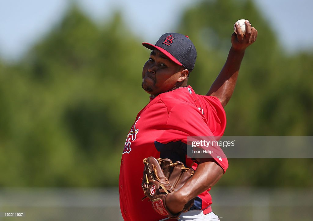 Victor Marte #66 of the St. Louis Cardinals pitches the live hitting session during spring training on February 20, 2013 in Jupiter, Florida.