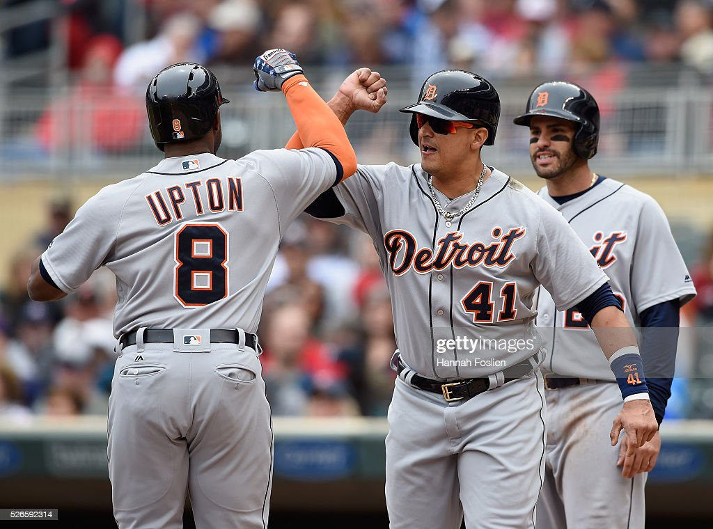 <a gi-track='captionPersonalityLinkClicked' href=/galleries/search?phrase=Victor+Martinez+-+Baseball+Player&family=editorial&specificpeople=210515 ng-click='$event.stopPropagation()'>Victor Martinez</a> #41 and <a gi-track='captionPersonalityLinkClicked' href=/galleries/search?phrase=J.D.+Martinez&family=editorial&specificpeople=7520024 ng-click='$event.stopPropagation()'>J.D. Martinez</a> #28 of the Detroit Tigers congratulate teammate <a gi-track='captionPersonalityLinkClicked' href=/galleries/search?phrase=Justin+Upton&family=editorial&specificpeople=846265 ng-click='$event.stopPropagation()'>Justin Upton</a> #8 on a three-run home run against the Minnesota Twins during the first inning of the game on April 30, 2016 at Target Field in Minneapolis, Minnesota.