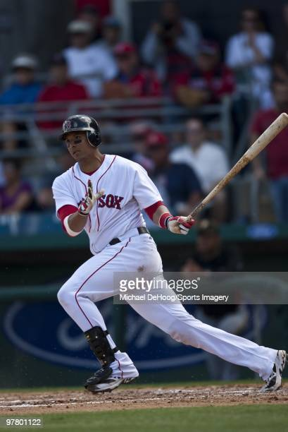 Victor Martinez of the Boston Red Sox bats against the Pittsburgh Pirates at at City of Palms Park on March 13 2010 in Fort Myers Florida