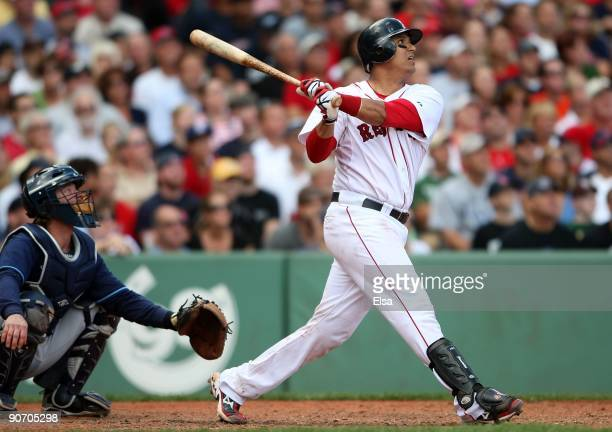 Victor Martinez of the Boston Red Sox gets a hit as Gregg Zaun of the Tampa Bay Rays defends on September 8 2009 at Fenway Park in Boston...