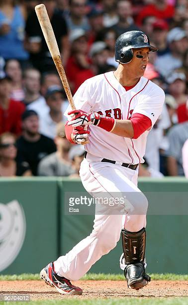Victor Martinez of the Boston Red Sox hits an RBI single in the sixth inning against the Tampa Bay Rays on September 13 2009 at Fenway Park in Boston...