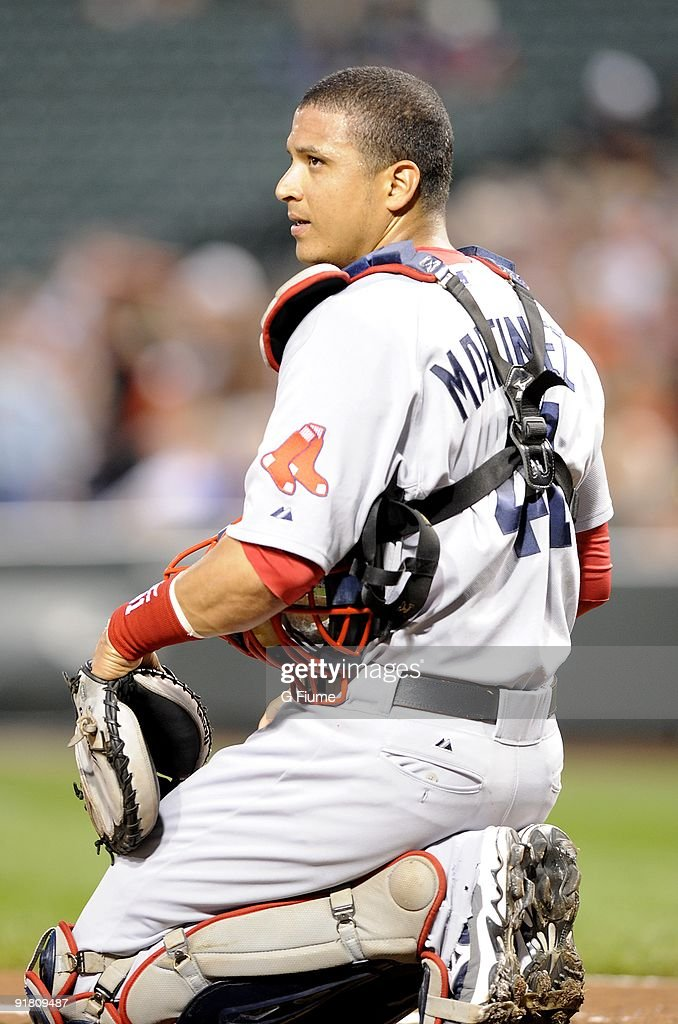 Victor Martinez #41 of the Boston Red Sox rests during a break in the game against the Baltimore Orioles on September 18, 2009 at Camden Yards in Baltimore, Maryland.
