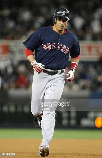 Victor Martinez of the Boston Red Sox rounds the bases after hitting a home run off of pitcher Joba Chamberlain of the New York Yankees in the fourth...