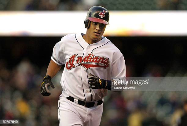 Victor Martinez of the Cleveland Indians rounds the bases after hitting a two run home run off of pitcher Curt Schilling of the Boston Red Sox in the...