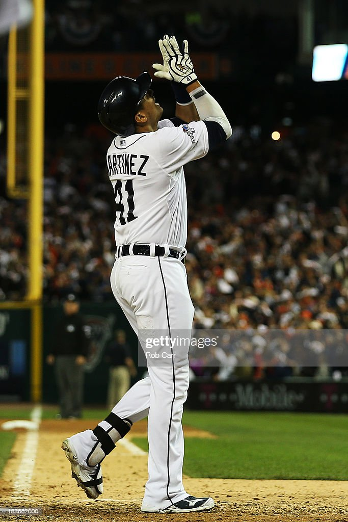 Victor Martinez #41 of the Detroit Tigers celebrates a seventh inning home run against the Oakland Athletics during Game Four of the American League Division Series at Comerica Park on October 8, 2013 in Detroit, Michigan.