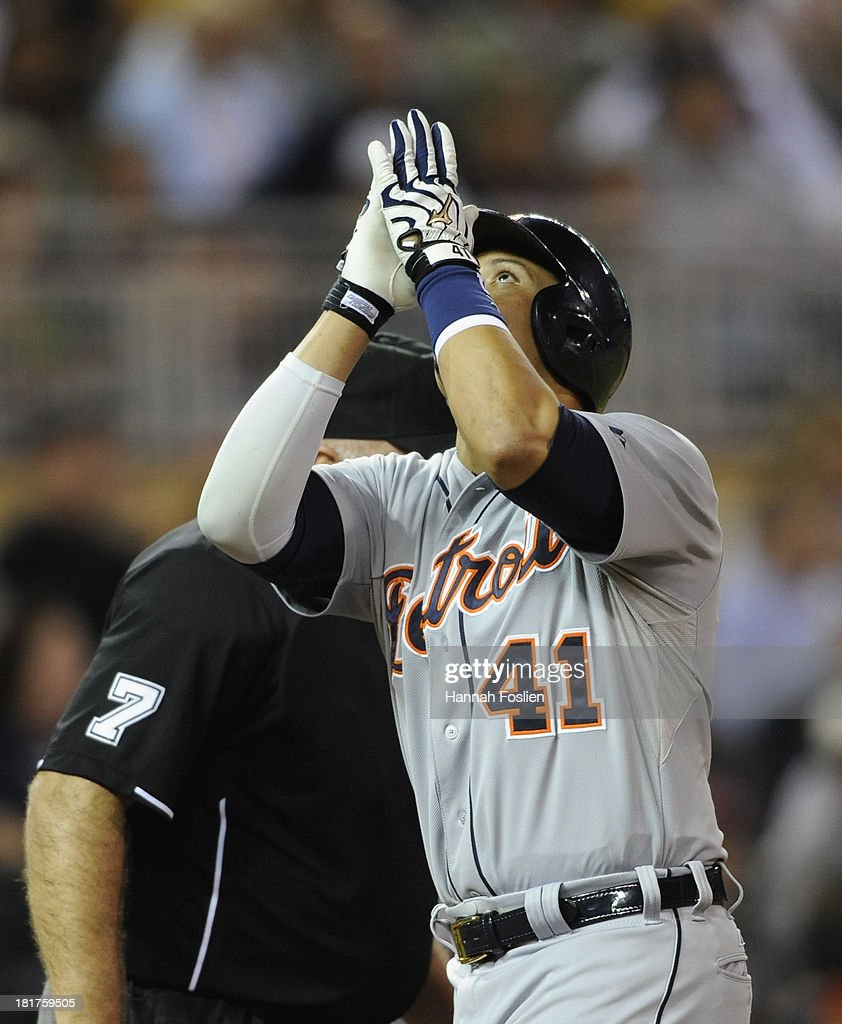 Victor Martinez #41 of the Detroit Tigers celebrates a solo home run against the Minnesota Twins during the fourth inning of the game on September 24, 2013 at Target Field in Minneapolis, Minnesota.