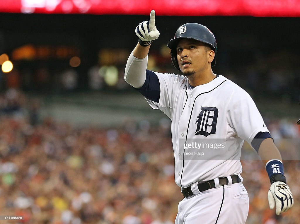 Victor Martinez #41 of the Detroit Tigers celebrates after hitting a first inning home run off pitcher Allen Webster #64 of the Boston Red Sox scoring Austin Jackson #14, Torii Hunter #48 and Miguel Cabrera #24 in the first inning of the game at Comerica Park on June 22, 2013 in Detroit, Michigan.