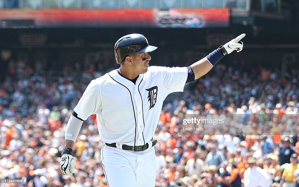 Victor Martinez #41 of the Detroit Tigers celebrates after hitting a solo home run in the fourth inning of the game against the Texas Rangers at Comerica Park on July 14, 2013 in Detroit, Michigan.