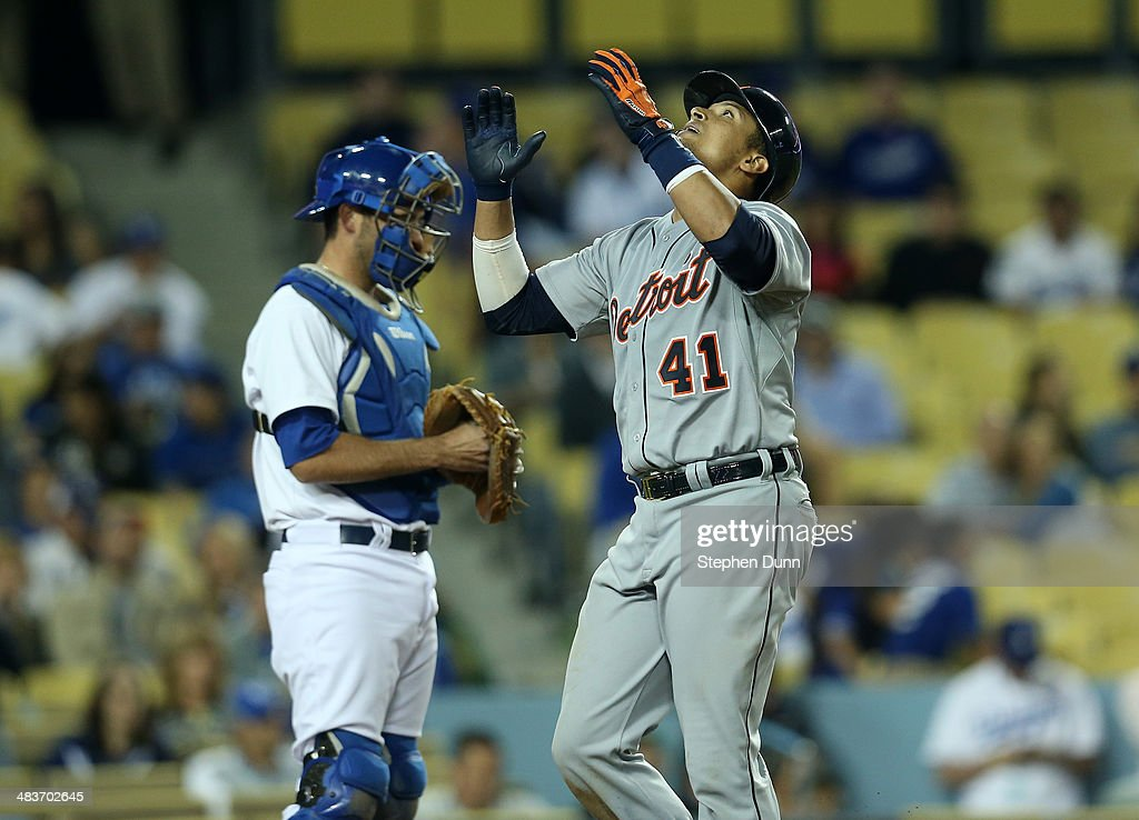 Victor Martinez #41 of the Detroit Tigers celebrates as he crosses home plate after hitting a leadoff home run in the tenth inning in front of catcher Tim Federowicz # 26 of the Los Angeles Dodgers at Dodger Stadium on April 9, 2014 in Los Angeles, California.