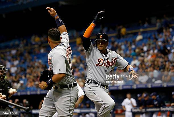 Victor Martinez of the Detroit Tigers celebrates at home plate with teammate Miguel Cabrera after hitting a threerun home run off of pitcher Danny...