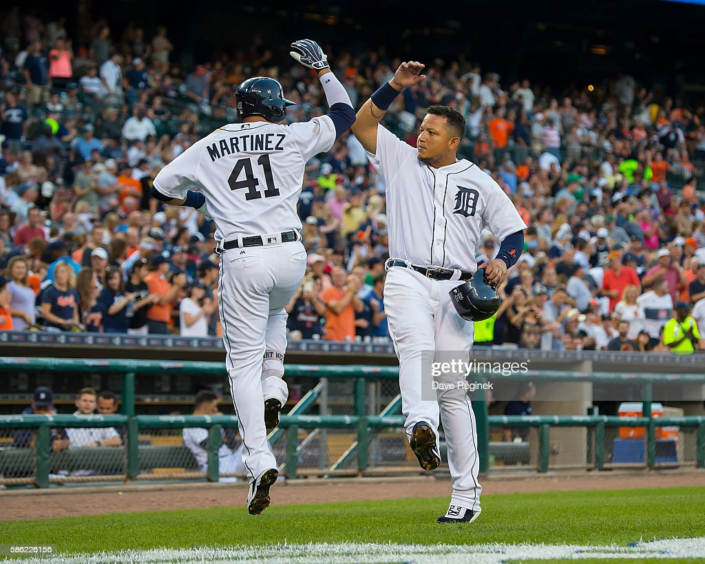 Victor Martinez #41 of the Detroit Tigers celebrates his two rum homer with teammate Miguel Cabrera #24 in the fourth inning during a MLB game against the New York Mets at Comerica Park on August 5, 2016 in Detroit, Michigan.