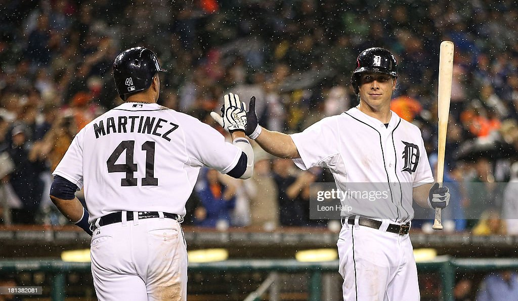 Victor Martinez #41 of the Detroit Tigers celebrates with teammate Andy Dirks #12 after hitting a two-run home run, scoring Prince Fielder (not pictured) in the fifth inning of the game against the Chicago White Sox at Comerica Park on September 20, 2013 in Detroit, Michigan.