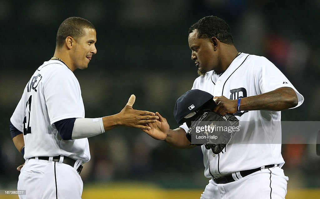 Victor Martinez #41 of the Detroit Tigers congratulates <a gi-track='captionPersonalityLinkClicked' href=/galleries/search?phrase=Jose+Valverde&family=editorial&specificpeople=689773 ng-click='$event.stopPropagation()'>Jose Valverde</a> #46 after the Tigers defeated the Royals at Comerica Park on April 24, 2013 in Detroit, Michigan. The Tigers defeated the Royal 7-5.