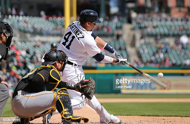 Victor Martinez of the Detroit Tigers doubles to deep center field scoring Ian Kinsler and Justin Upton during the sixth inning of the interleague...
