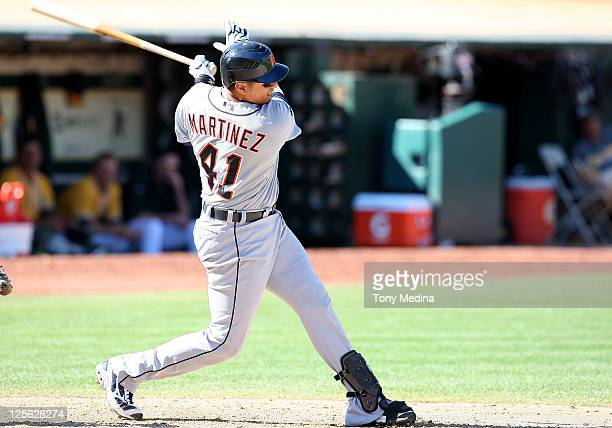 Victor Martinez of the Detroit Tigers follows through after swinging at a pitch at Oco Coliseum on September 18 2011 in Oakland California