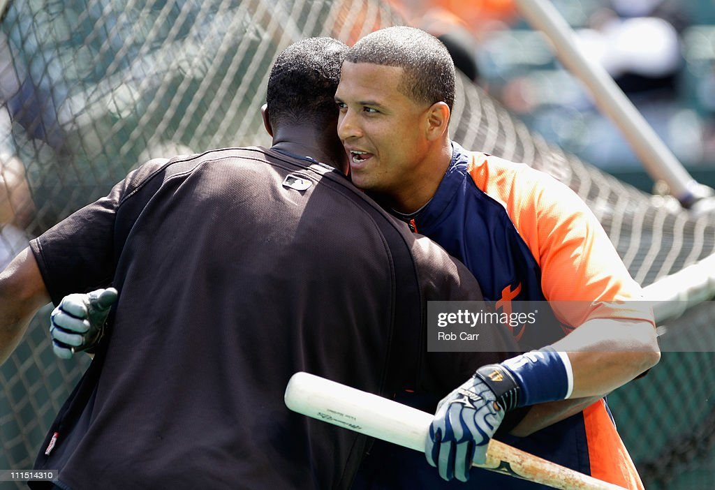 Victor Martinez #41 of the Detroit Tigers greets Adam Jones #10 of the Baltimore Orioles during opening day at Oriole Park at Camden Yards on April 4, 2011 in Baltimore, Maryland.