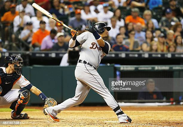Victor Martinez of the Detroit Tigers hits a double in the eleventh inning to score Jose Iglesias against the Houston Astros at Minute Maid Park on...