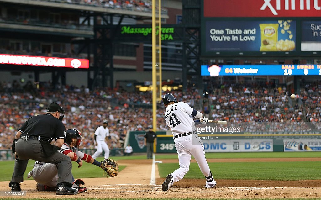 Victor Martinez #41 of the Detroit Tigers hits a first inning home run off pitcher Allen Webster #64 of the Boston Red Sox scoring Austin Jackson #14, Torii Hunter #48 and Miguel Cabrera #24 in the first inning of the game at Comerica Park on June 22, 2013 in Detroit, Michigan.
